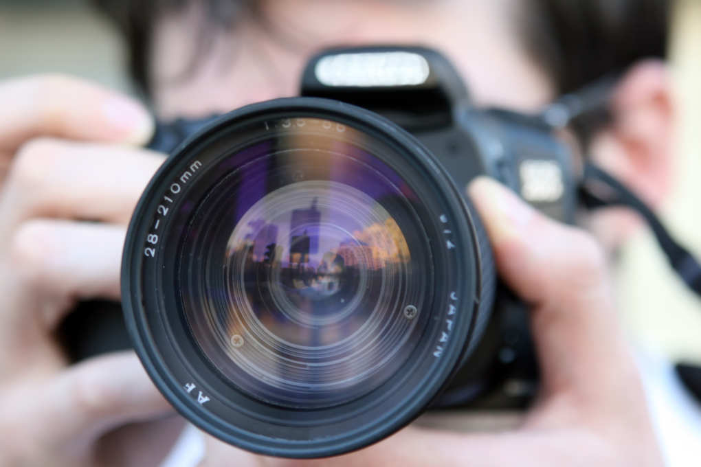 What does the law say about private detectives and photography?
